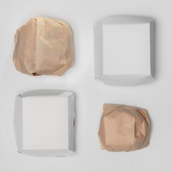 Bovenaanzicht verpakte hamburger met blanco pakketten