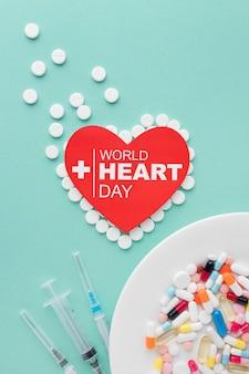 Bovenaanzicht wereld hart dag concept met geneeskunde