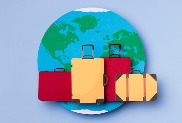 Bovenaanzicht wereldtoerisme dag met bagage