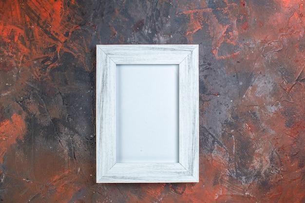 Bovenaanzicht witte fotolijst elegant op donkere achtergrond foto aanwezig cadeau kleur duisternis