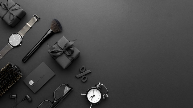 Bovenaanzicht zwarte vrijdag arrangement op zwarte achtergrond met kopie ruimte