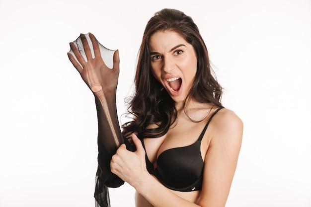 Boze schreeuwende vrouwenholding scheurde zwarte panty