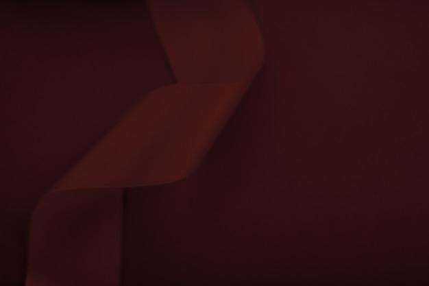 Branding vakanties en luxe merken concept abstract zijden lint op chocolade achtergrond exclusieve lu...