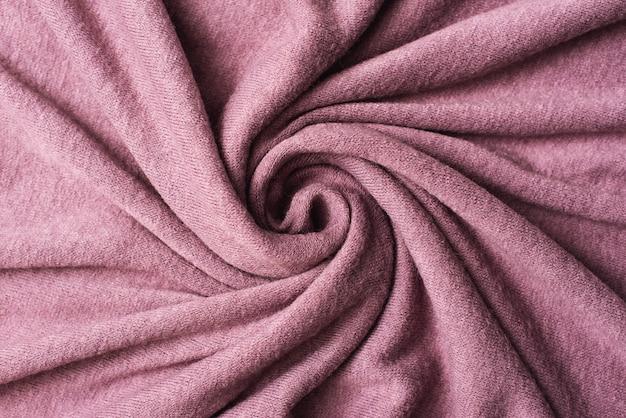 Brei violette sweater als achtergrond. lila gebreide staal.