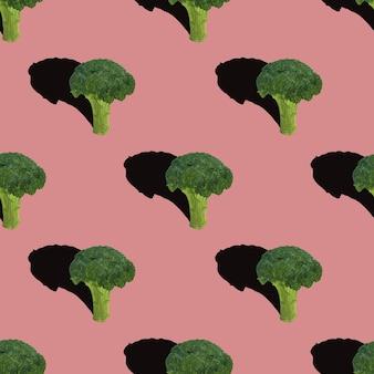 Broccoli naadloze patroon op rood