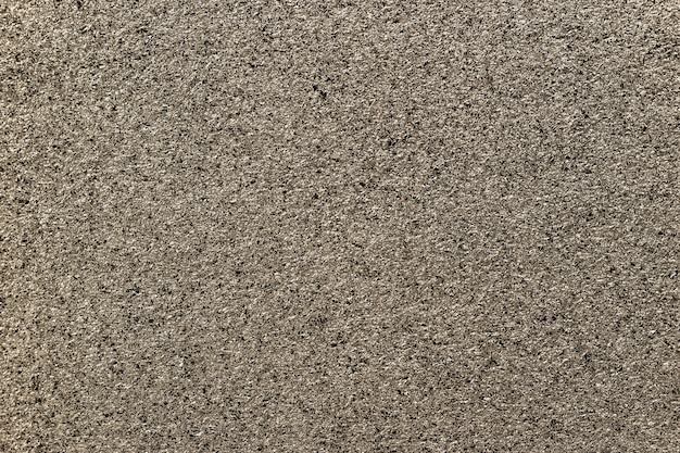 Brons sprankelende achtergrond van kleine pailletten, close-up. bruin metallic papier achtergrond van folie.