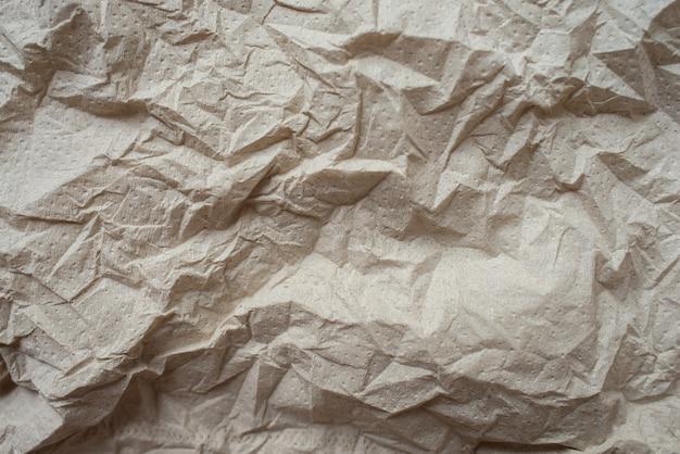 Brown crumpled paper textured background