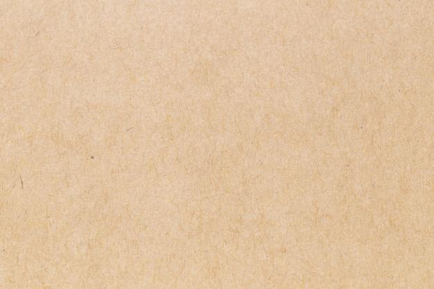 Bruin eco gerecycled kraftpapier blad textuur kartonnen achtergrond.