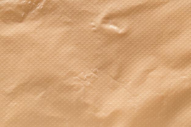 Bruin eco gerecycled plastic zak textuur achtergrond.