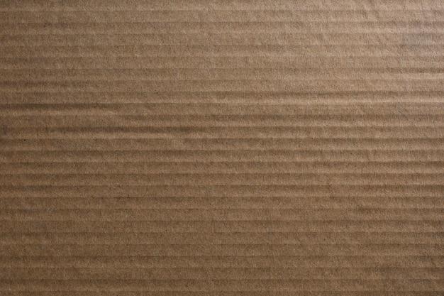Bruin gegolfd papier getextureerde achtergrond