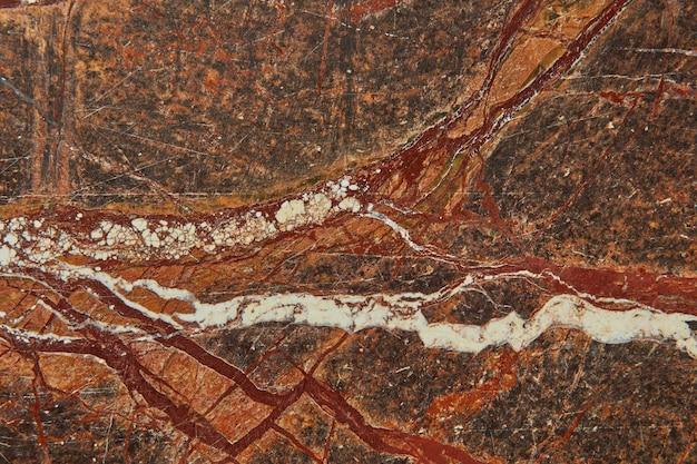 Bruin granieten oppervlak van grafische abstracte getextureerde stenen patroon achtergrond, kopieer ruimte. natuurlijke achtergrond voor interieurdecoratie.