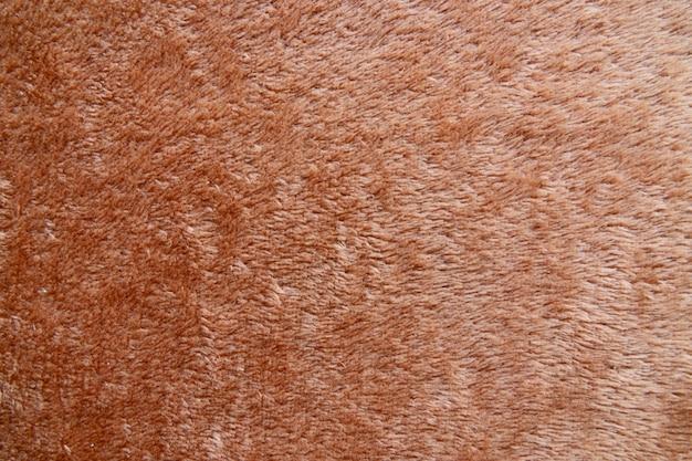 Bruin handdoektextuur achtergrondclose-up