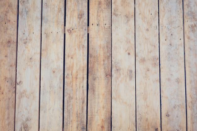 Bruin houten paneel langssamenstelling naar beneden de houten wand is gemaakt van rubberboom.