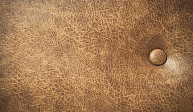 Bruin lederen sofa textuur achtergrond.