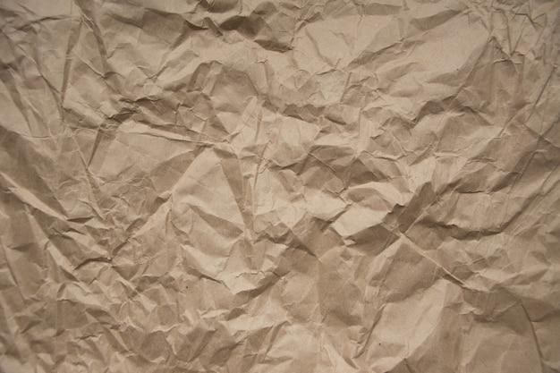 Bruin ruw verfrommeld gerecycled papier textuur bruin