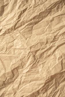 Bruin verfrommeld papier close-up textuur achtergrond