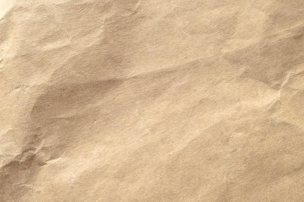 Bruin verfrommeld papier textuur achtergrond.