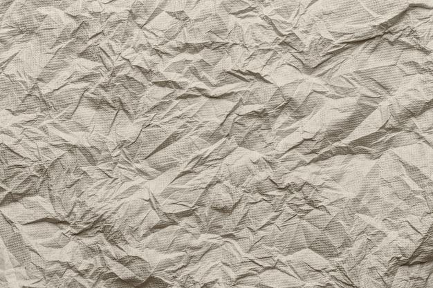 Bruin weefsel oppervlak van gerimpeld of verfrommeld.