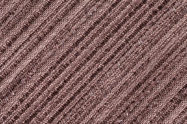 Bruine achtergrond van een gebreide textielstof