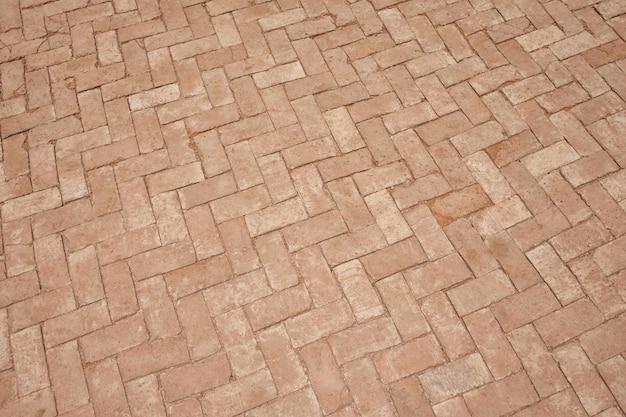Bruine baksteengang van textuurachtergrond.