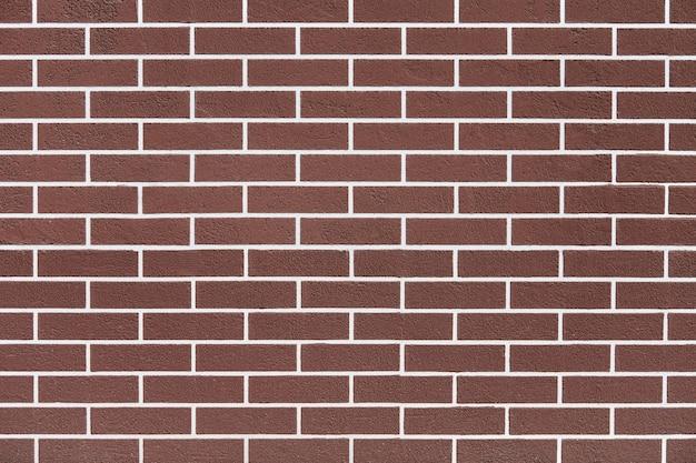 Bruine bakstenen muur met het witte patroon van voeglijnen. de abstracte achtergrond van de baksteentextuur. nieuw huis exterieur. loft ontwerp.
