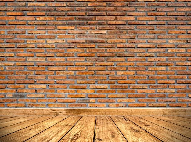 Bruine bakstenen muur textuur en houten vloer.