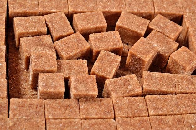 Bruine geraffineerde suiker als achtergrondstructuur