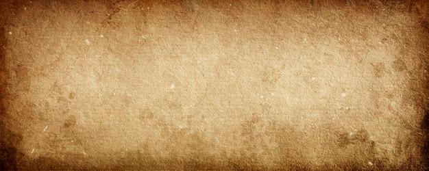 Bruine grungeachtergrond van oud document