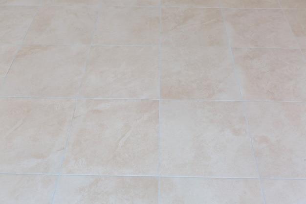 Bruine keramische vloertegels close-up textuur