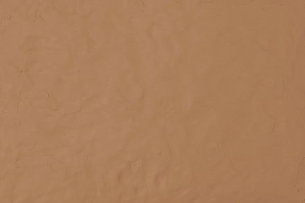 Bruine klei getextureerde achtergrond in aardetint diy creatieve kunst minimale stijl