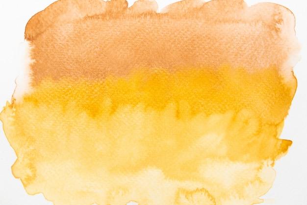 Bruine, oranje en gele aquarel op papier.