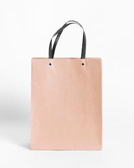 Bruine papieren draagtas om te winkelen met schaduwen