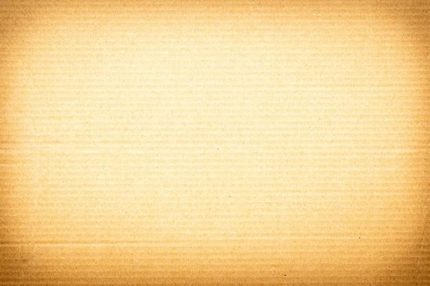 Bruine papieren textuur achtergrond of kartonnen oppervlak van een kartonnen doos voor verpakking.
