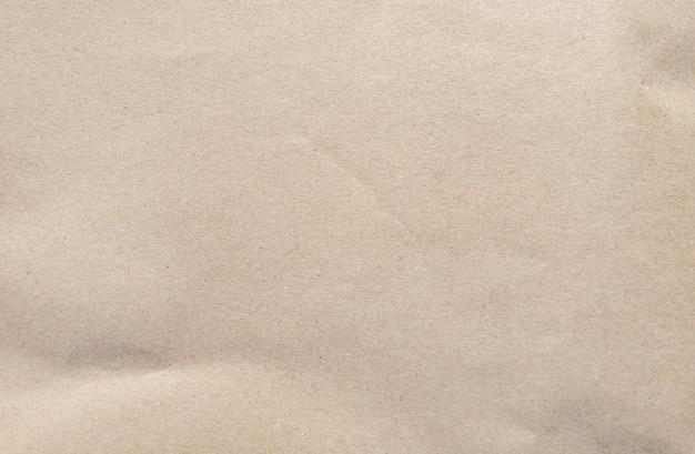 Bruine papieren textuur. gerimpelde kringloopdocument achtergrond