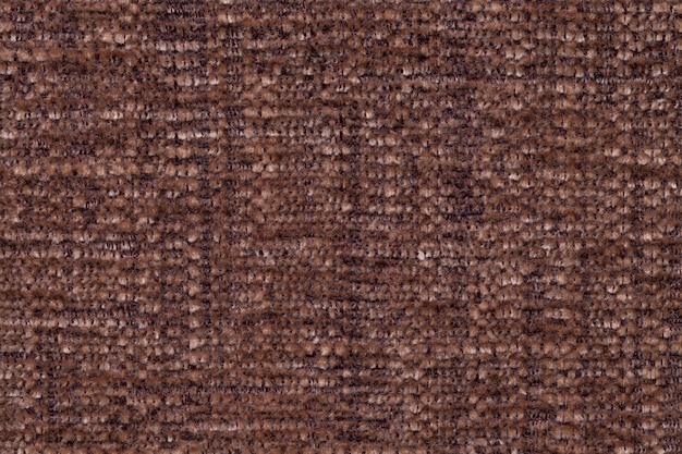 Bruine pluizige achtergrond van zachte, wollige doek. textuur van textielclose-up