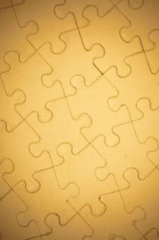 Bruine puzzelachtergrond.