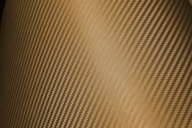 Bruine samengestelde grondstofachtergrond van de koolstofvezel