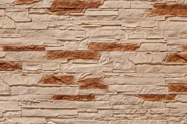 Bruine stenen muur gemaakt met blokken. patroon van de textuur en de achtergrond van de leimuur