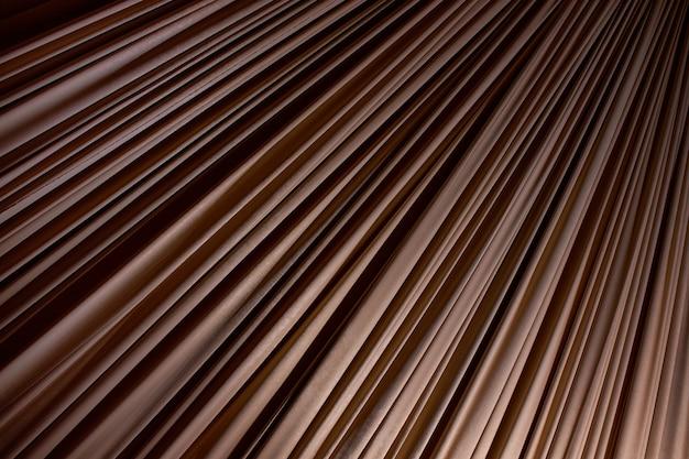 Bruine stof met veel plooien als achtergrond