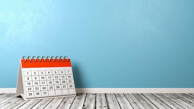 Bureaukalender op houten vloer tegen muur