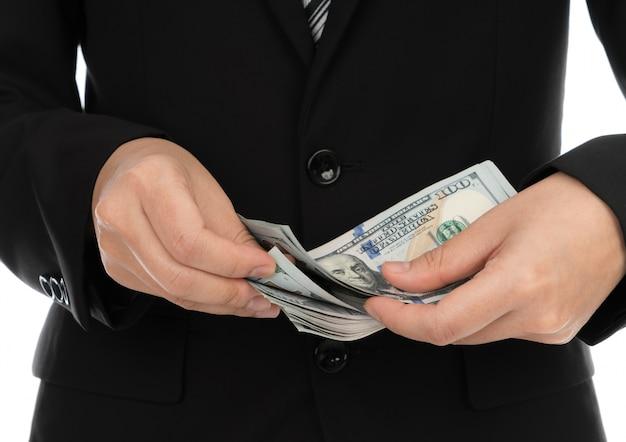 Business man met een spreiding van de dollar