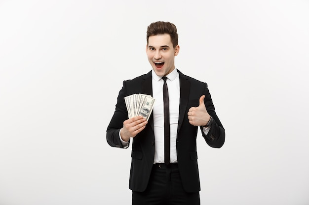 Businessconcept - succesvolle zakenman dollarbiljetten te houden en duim opdagen geïsoleerd op witte achtergrond.