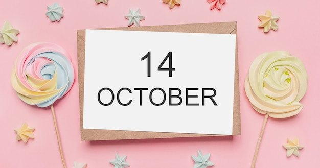 Cadeaus met briefje op roze ondergrond met snoepjes met tekst 14 oktober