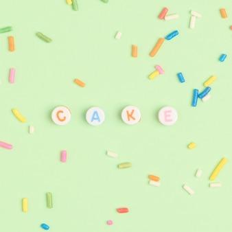Cake kralen tekst typografie op groen