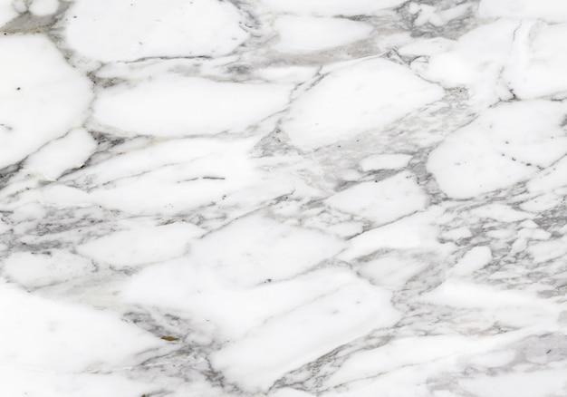 Calacatta-marmertextuur gemaakt van een mix tussen pure witte en grijze tinten. witte stenen achtergrond.