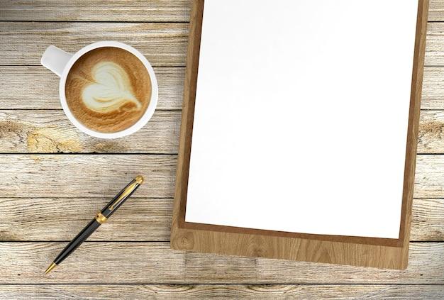 Cappuccinokoffiekop met lege documenten op klembord en ballpoint