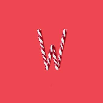 Caps snoep en suiker lettertype. letter w