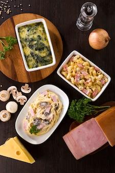 Carbonara-spaghetti, macaroni-hamkaas en gebakken spinazie met kaas