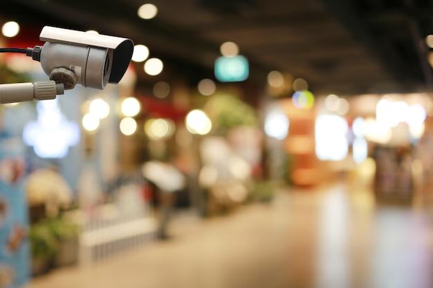 Cctv-tool in winkelcentrum apparatuur voor beveiligingssystemen en kopieerruimte voor ontwerp.