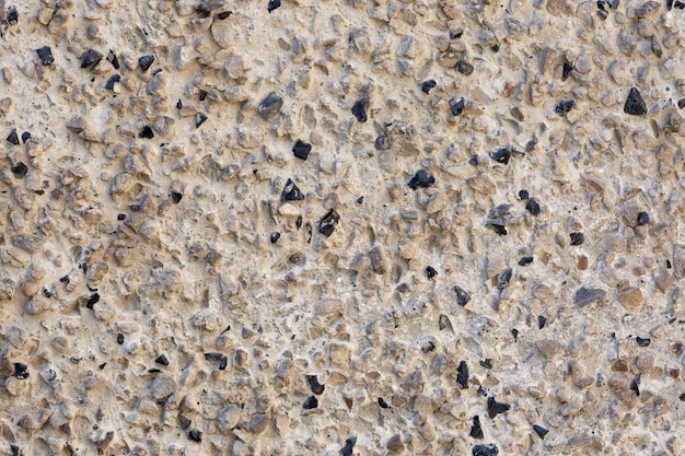 Cementmuur met stenen abstracte achtergrond, obsidiaanstenen